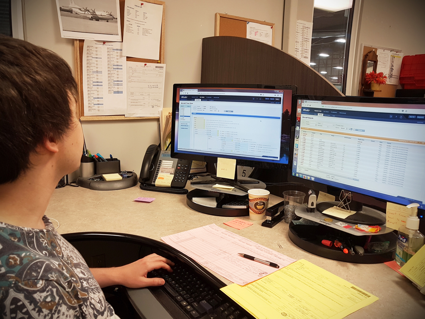 Calm Air Technical Records Clerk using WinAir at workstation