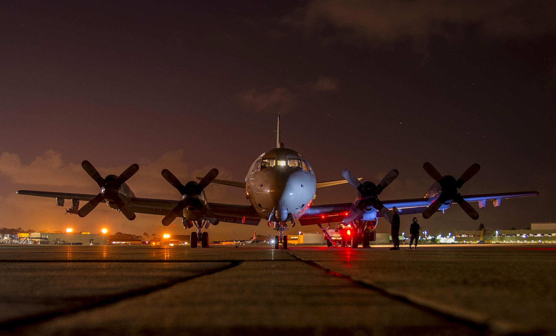 Lockheed P-3 Orion Aircraft on runway at night