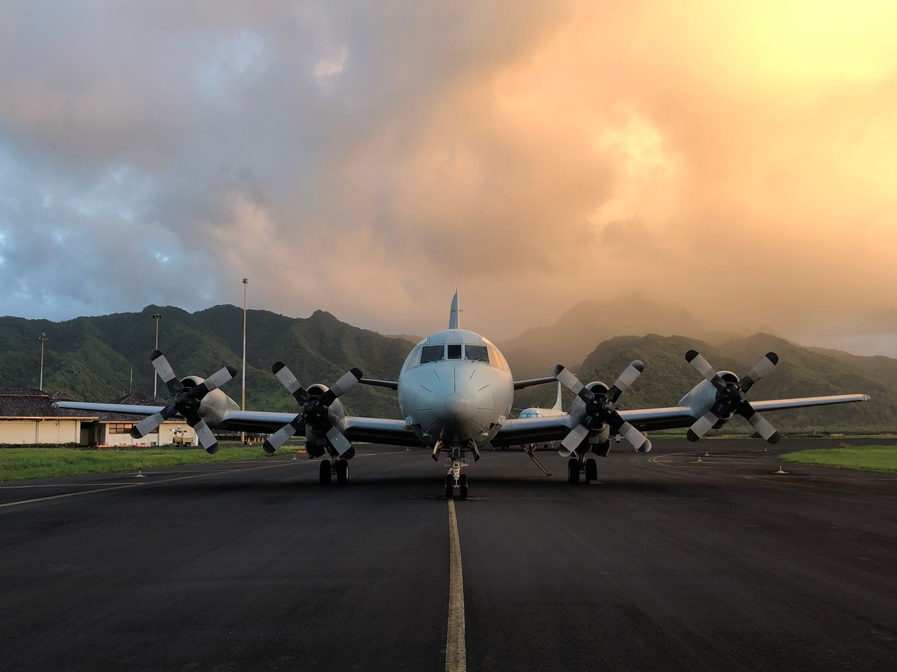 MHD-ROCKLAND Services - P-3C Aircraft on runway with mountains in background