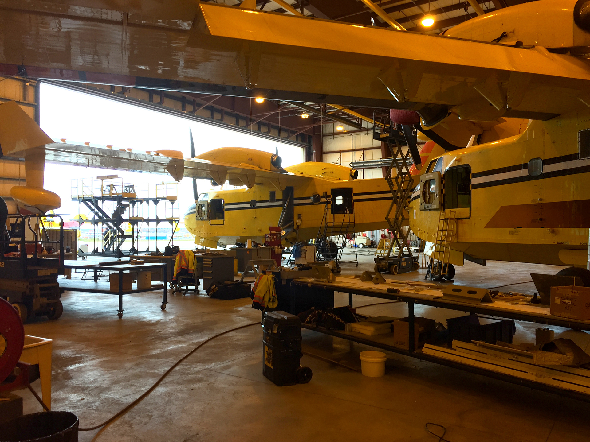 CL-415 aircraft undergoing maintenance in hangar