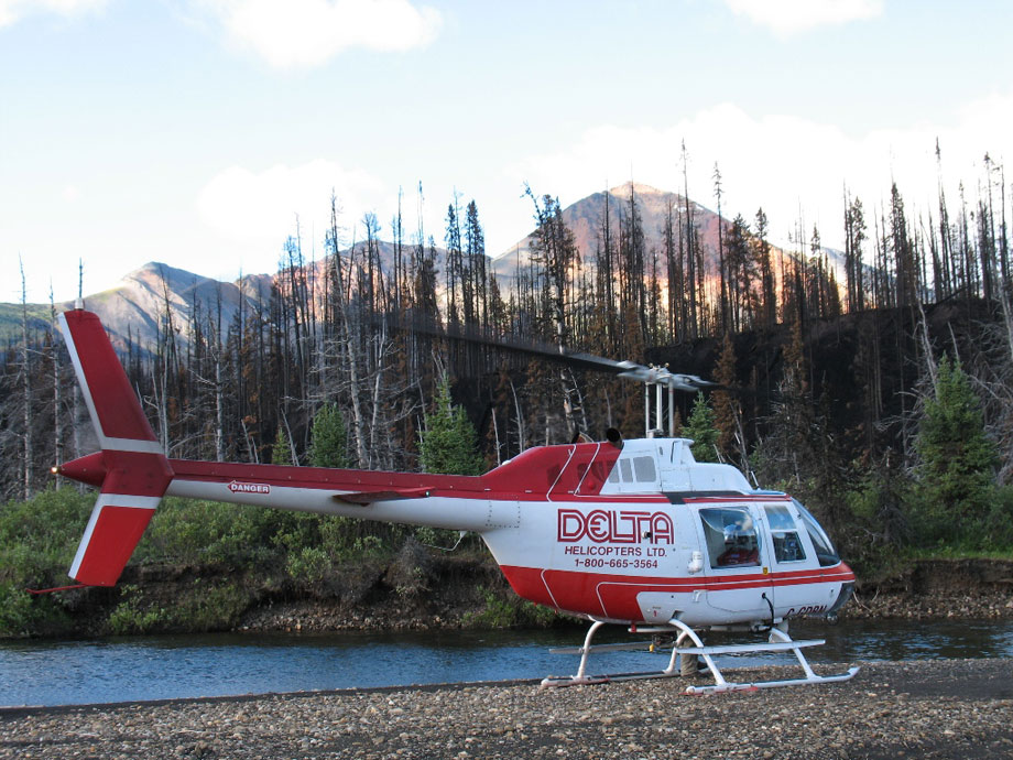 Delta Helicopters Bell 206B helicopter prepares for liftoff from a remote location in Alberta, Canada