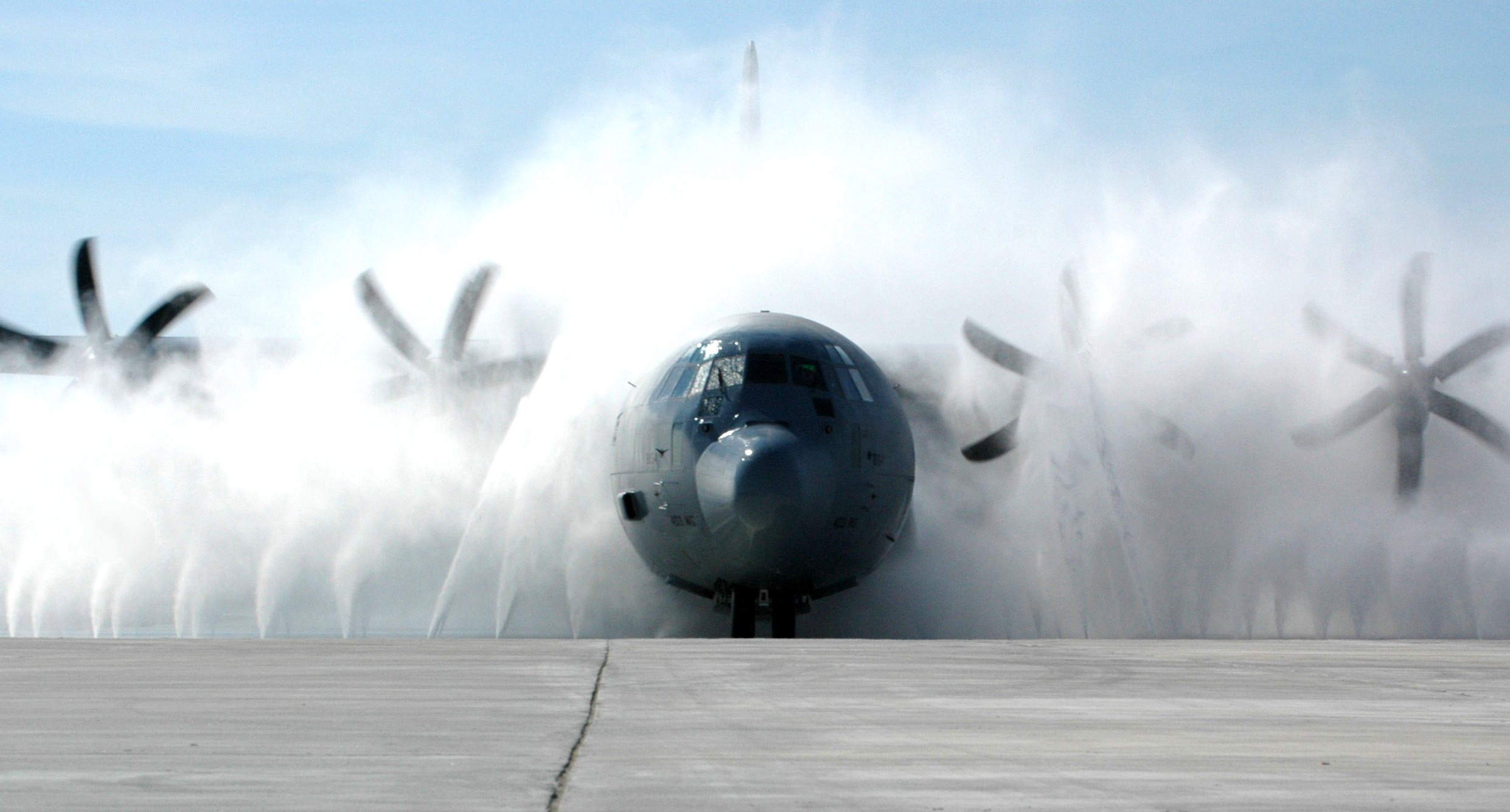 A Lockheed C-130J Hercules aircraft undergoes routine cleaning
