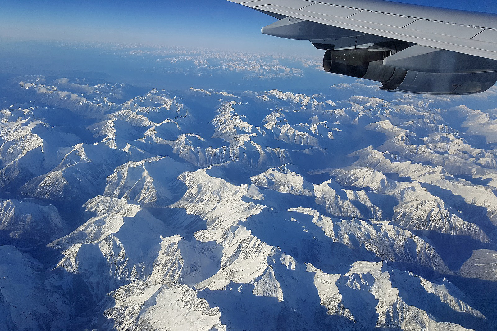 Airplane Wing and Mountains
