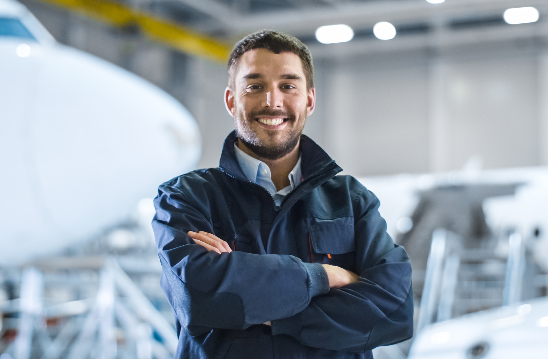 Business Owner and Aircraft in Maintenance Hangar