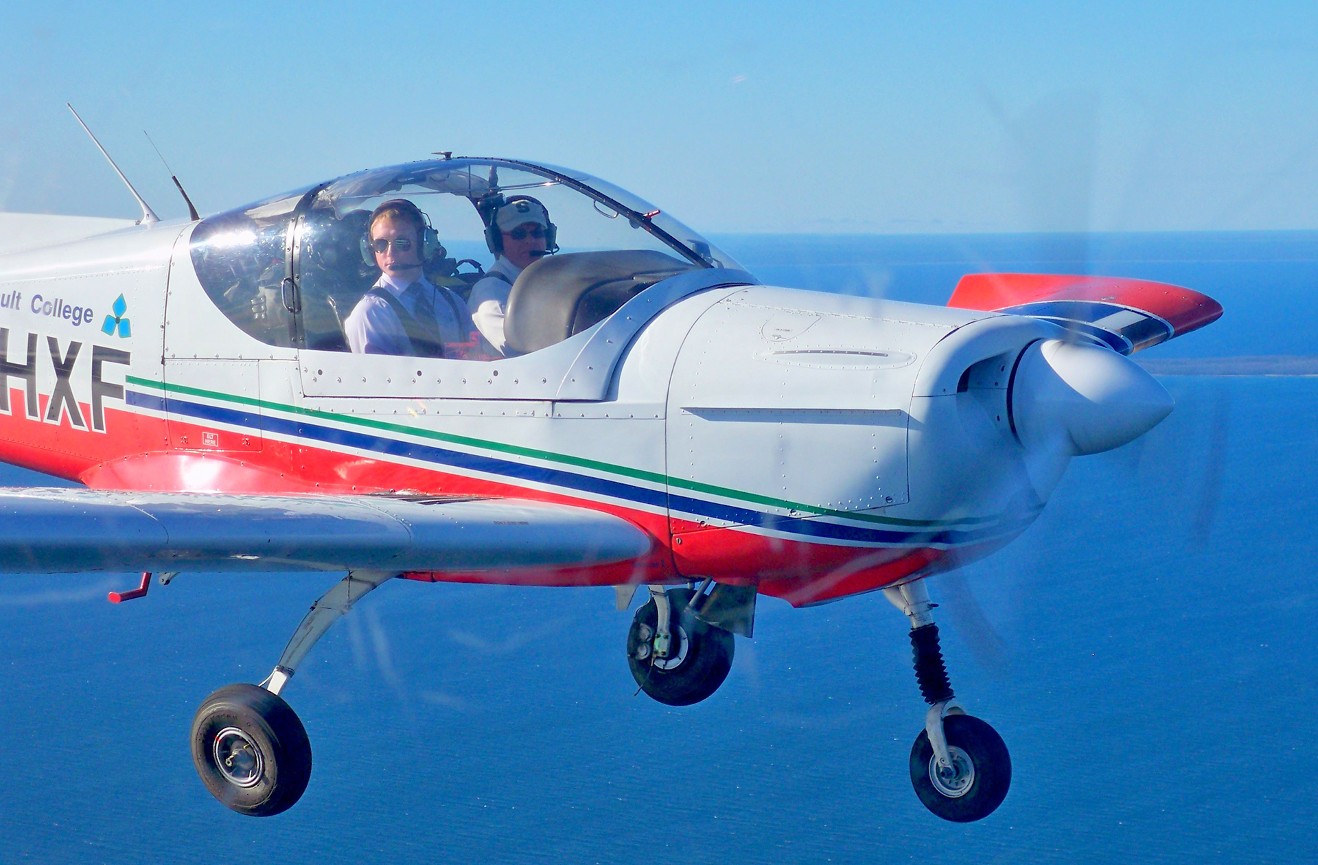 Instructor and Student Fly a Zlín Z-242L Single-engine Trainer aircraft