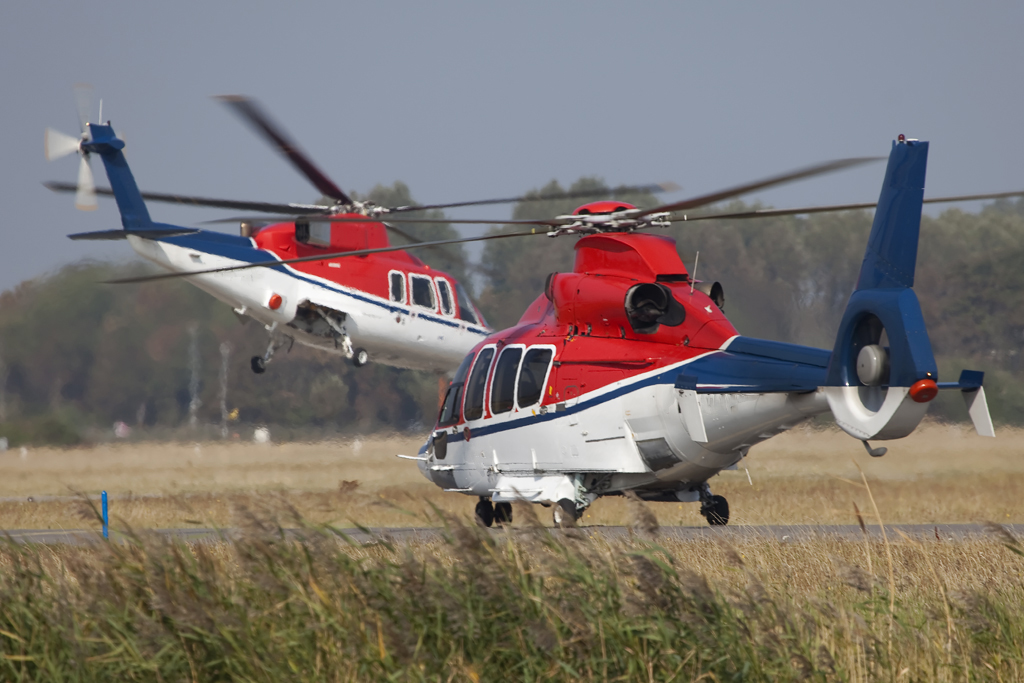 Two Sikorsky S-76 helicopters appear at the Heldair Show Maritiem show