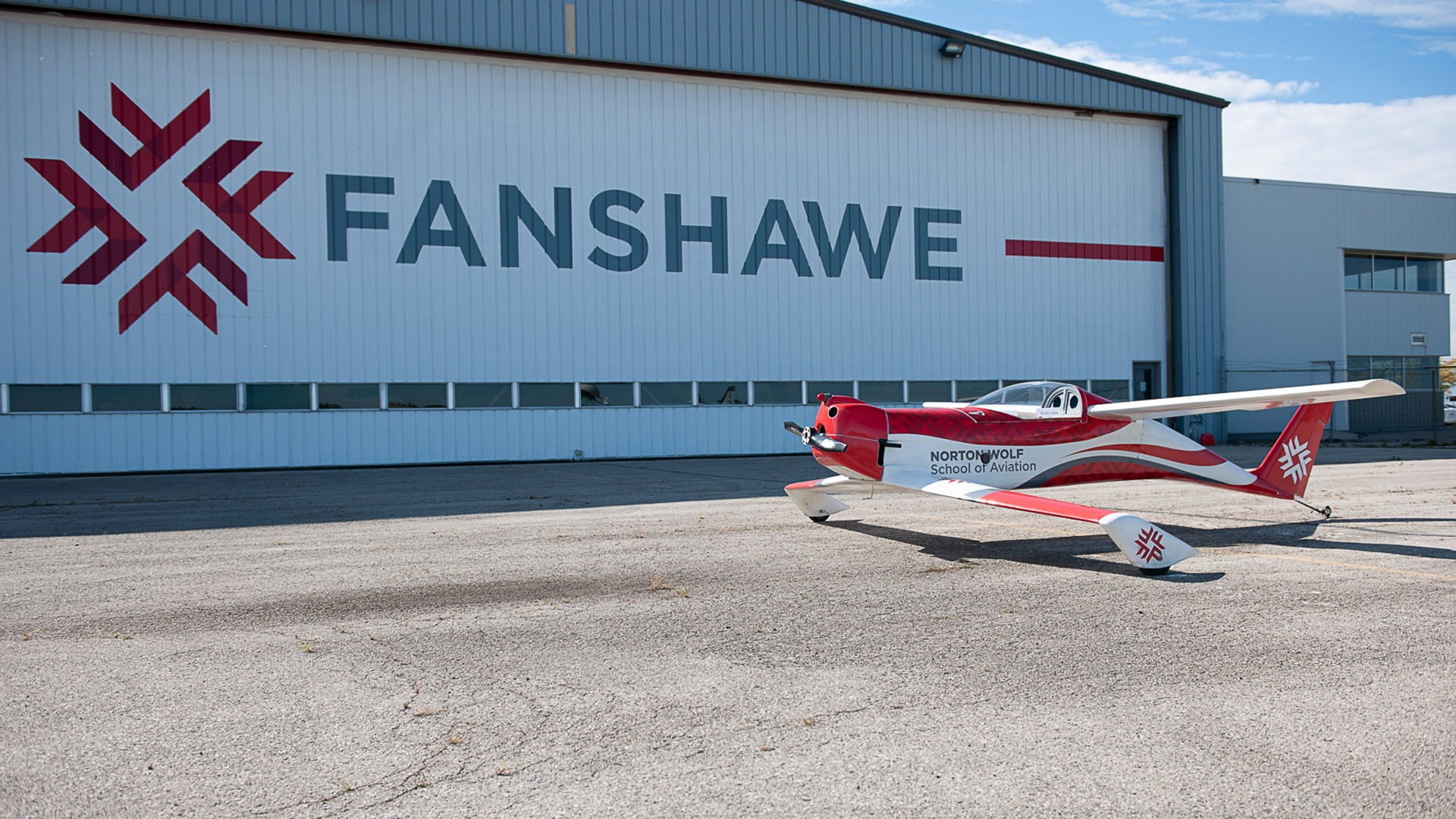 The outside of the maintenance hangar at Fanshawe College's Norton Wolf School of Aviation Technology